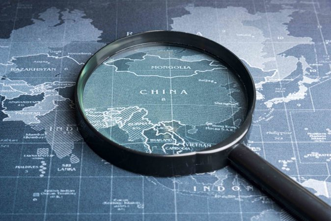 Magnifying glass on the world map.Business exploration system concept